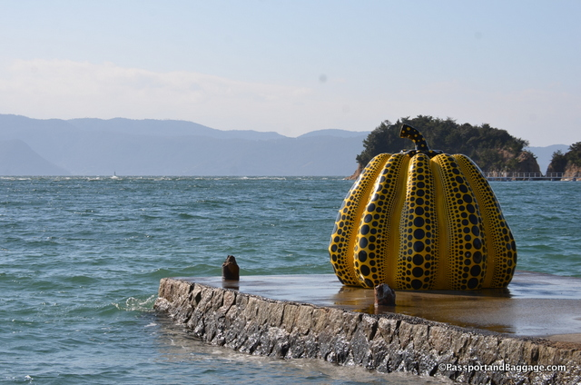Pumpkin by Yoyoi Kusama is the signature piece of Naoshima Island. The Yellow Pumpkin sits on a pier in front of the Benesse Park Hotel