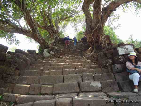 Up  These stairs leading up to the central temple are unleveled, eroded, and in odd states of disarray. Throw in the fact that they are immensely steep and not always wide enough for an entire foot . . .