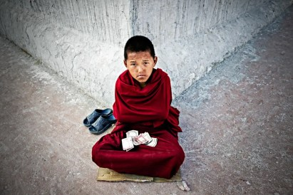 Buddhist child asking for alms