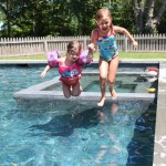 First cousins and beginning swimmers, Camille Beard and Stella Schafer, taking the big leap.
