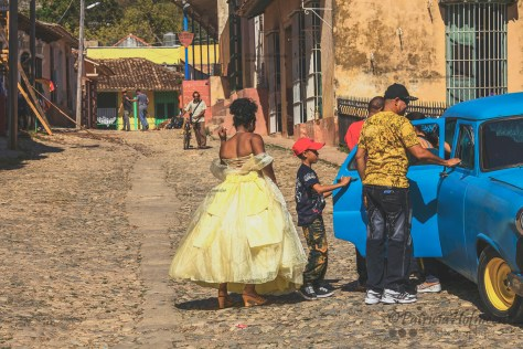 Wedding party in color on a street in Trinidad, Cuba