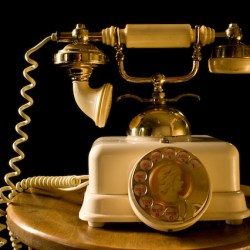 Old telephone being superceded by smartphones