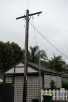 an old telephone pole shows the poor standard of Aussie comms