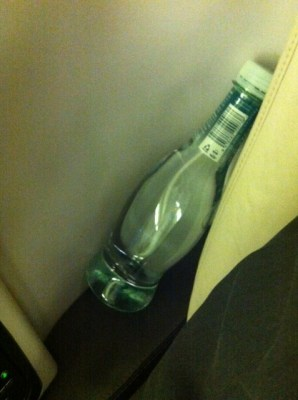 Air New Zealand premium economy storage and water bottle