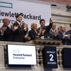 Meg Whitman (center), President and Chief Executive Officer of Hewlett Packard Enterprise, rings the opening bell of the New York Stock Exchange on November 2, 2015. CREDIT: Eric Draper