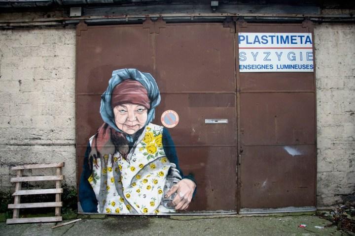 Homeless woman portrait by street artist Specter in Paris