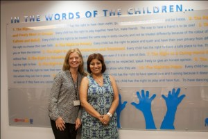 Vicky Lowrey, Senior Service Manager at Peel CAS, and Shelina Jeshani, Director, Success By 6 Peel, stand with the new Children's Charter of Rights mural at Peel CAS.