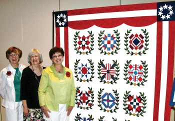 WWI Quilt, left to right: Jan Johnson and Erma Taylor (co-chairs); quilted by Cindy Santoro