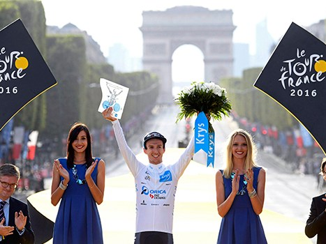 Adam Yates on the podium following his win of the Young Rider category in the 2016 Tour de France