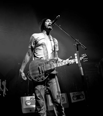 Michael Franti in performance in Asheville, NC (Courtesy photo).