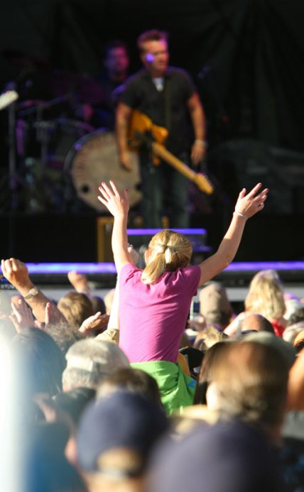 A young girl on the shoulders of an adult watches John Mellencamp at Dehler Park in Billings on Aug. 11.