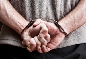 Criminal in handcuffs - Idaho Falls Criminal Attorney