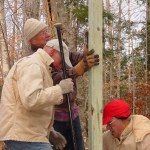 Peninsula Friends volunteers Bill Schaars and park staff Jeff Lange install new fencing at the deer exclosure cage on Middle Road.