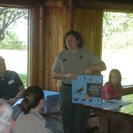 Supt. Kelli Bruns shows Bird Songs Bible, donated as a memorial to the Nature Center.