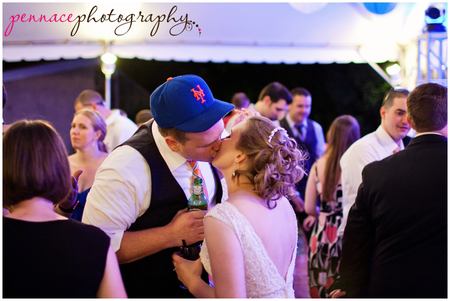 candid of bride and groom kissing