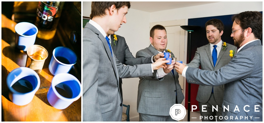 groom and groomsmen doing a shot