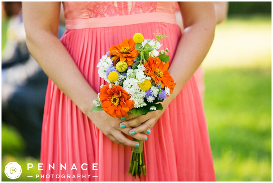 coral bridesmaid dress and bright bouquet
