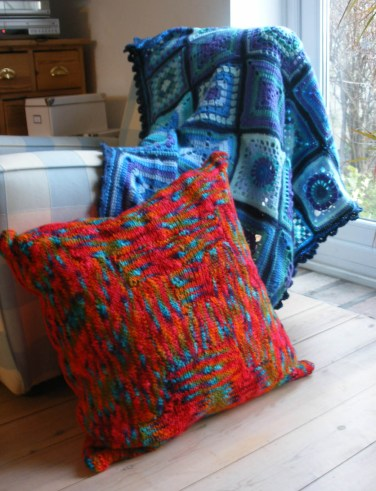 Crochet blanket and knit cushion
