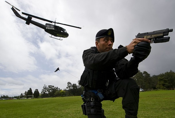 WITH AFP HISTORY BY JOSE BAUTISTA A Colombian police officer from an anti-terrorist unit takes part in a demonstration of the security plan for the FIFA U-20 World Cup that will be held in Colombia between July 29 and August 20, in Bogota, on July 23, 2011. AFP PHOTO/Luis Acosta (Photo credit should read LUIS ACOSTA/AFP/Getty Images)