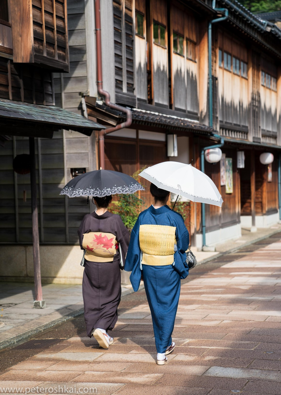 Women in traditional clothes in Hagashi Ochaya district in Kanazawa. Japan.