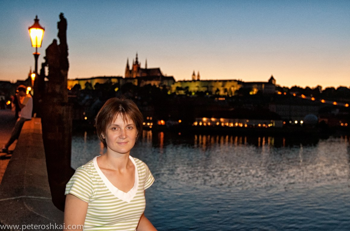 Portrait of a young woman on a Charles Bridge in Pargue. Czech Republic