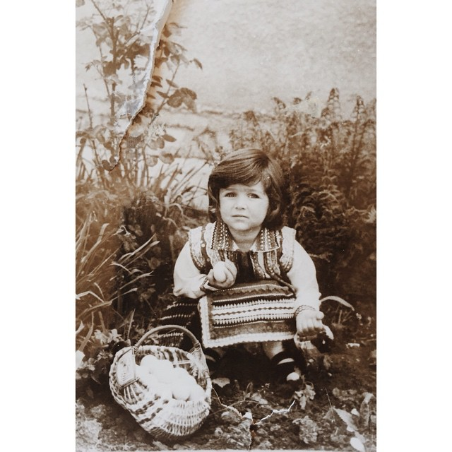 The Orthodox Christians celebrate St Lazarus today. On this day young girls go from house to house, sing songs and gather eggs to be painted for Easter. This is 5 yo Petya with her bounty in grandma's back yard. I don't seem too happy about it too, wonder why :)