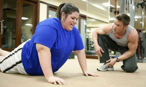 overweight woman working out