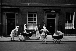 GB. England. Nannies Outside No.10. Downing Street was open to the public in those days and each afternoon the same nannies would pause to chat up the policemen on duty. 1959.