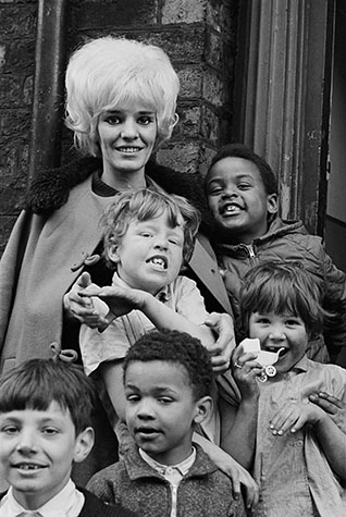 G.B. ENGLAND. Liverpool. Mother and daughter with local children. 1966.