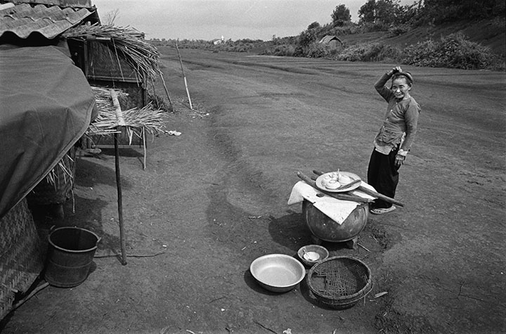 VIET NAM. Khe Sanh. This old lady built her house at the edge of the old US-built runway and in doing so became the first person to live in the base since the Americans left.