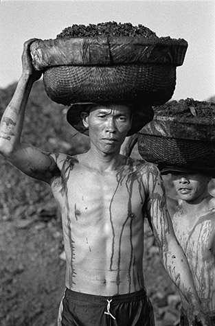 VIETNAM. A few kilometres north of picturesque and frequently visited Ha Long Bay is the coal mining area that tourists rarely see. Hong Gai is the port where coal is shipped from nearby mines, with much of the work done by hand. 2000.