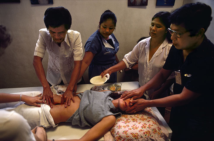 PHILIPPINES. Religion in the Philippines. Psychic bare-handed surgery practised by charlatans who fake removal of cancerous tumors. Practitioners appear to make an incision, put their fingers in the body and remove the tumors. After wiping away the blood there is no evidence that the skin was penetrated. 1981.