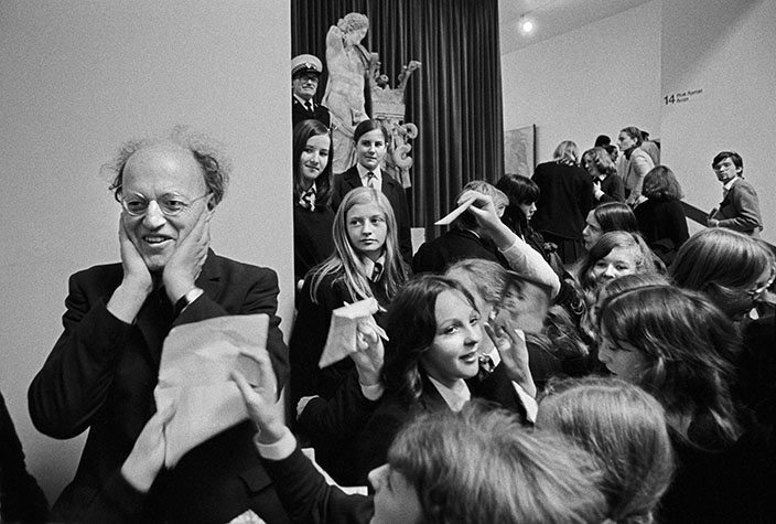 GB. England. Lord Longford (Lord Porn) visiting the British Library, surrounded by school girls. 1973.