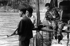 "THAILAND. Bangkok. 1977. Robert DENIRO (right) and director Michael CIMINO (center) on location during the filming of ""The Deerhunter."""