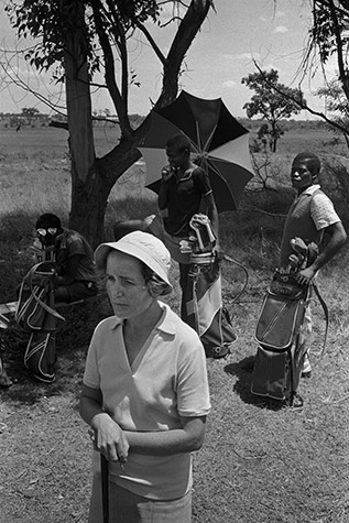 Before the county became independent Zimbabwe, the whites, who ran everything, had a privileged existence. They offered specialized employment opportunities to generations of young black males- as golf caddies. 1965