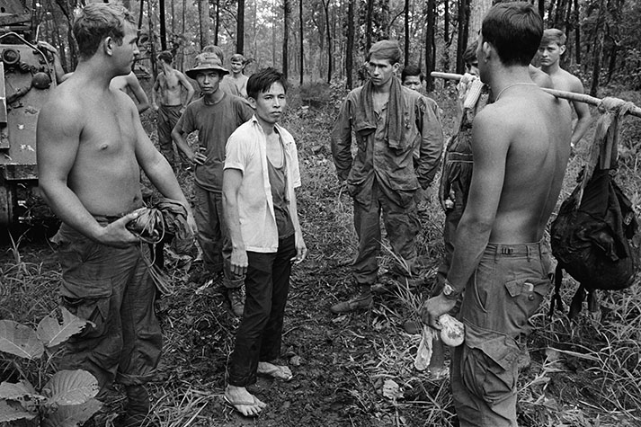 CAMBODIA. His lack of equipment is a constant source of wonder to the GI's. Surrounded, this Vietcong
