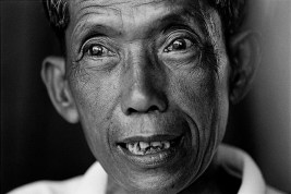 "CAMBODIA. 1999.  Kang Kek Ieu aka ""DUCH,"" the former director of the Tuol Sleng Prison in Phnom Penh, where the  Khmer Rouge killed over 16,000 Cambodians.    Between 1975 and 1979, two million Cambodian people, one out of every six in the country, died under the Khmer Rouge rule.  Dutch, aka Kang Kek Ieu, ran the most notorious prison during the Khmer Rouge regime.  Dutch was director of Tuol Sleng, a Phnom Penh high school converted into a tourture chamber.  It was estimated that 16,000 people were tortured there.  Only seven survivors remain.  Dutch, a converted Christian who has worked with International Aids Groups, has expressed remorse and willingness to stand trial for his crimes."