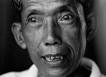 """CAMBODIA. 1999.  Kang Kek Ieu aka """"DUCH,"""" the former director of the Tuol Sleng Prison in Phnom Penh, where the  Khmer Rouge killed over 16,000 Cambodians.    Between 1975 and 1979, two million Cambodian people, one out of every six in the country, died under the Khmer Rouge rule.  Dutch, aka Kang Kek Ieu, ran the most notorious prison during the Khmer Rouge regime.  Dutch was director of Tuol Sleng, a Phnom Penh high school converted into a tourture chamber.  It was estimated that 16,000 people were tortured there.  Only seven survivors remain.  Dutch, a converted Christian who has worked with International Aids Groups, has expressed remorse and willingness to stand trial for his crimes."""