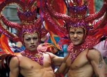New York City. Gay Pride Parade. Two men sport elaborate headdresses.