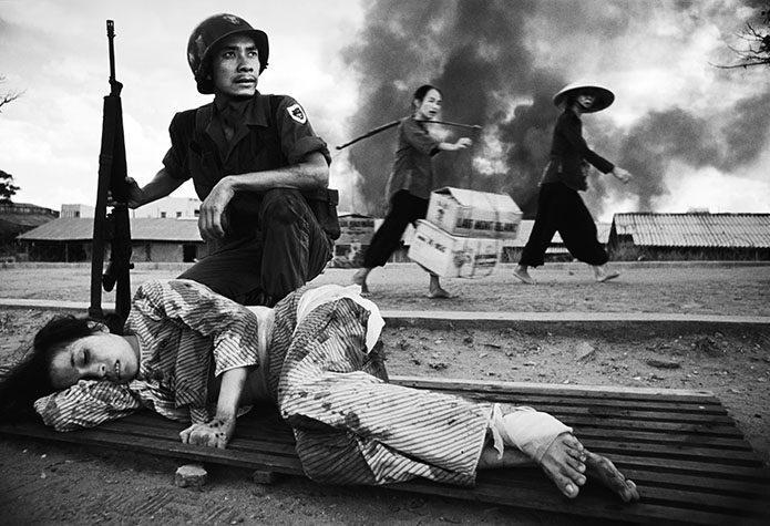 VIETNAM. The battle for Saigon. U.S. policy in Vietnam was based on the premise that peasants driven into the towns and cities by the carpet-bombing of the countryside would be safe.  Furthermore, removed from their traditional value system they could be prepared for imposition of consumerism. This