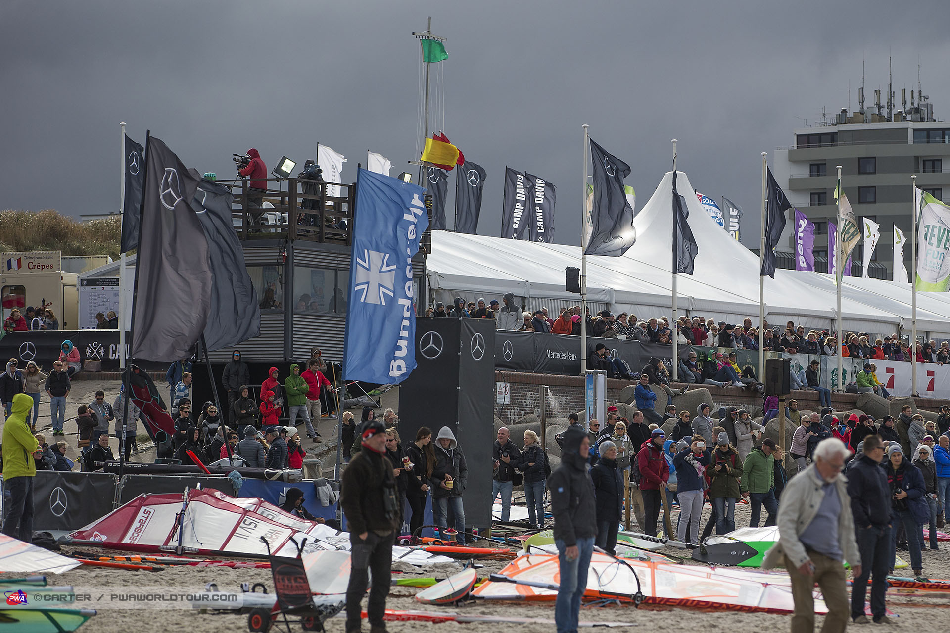 Spectators watch the action as the green flag goes up for a freestyle heat at the PWA Sylt Windsurf World Cup