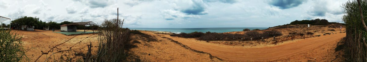 Panorama of Espaco Serramar during the day over-looking Praia de Malhada and the Serrote hill.