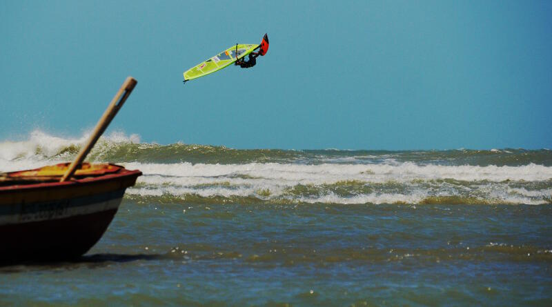 Phil Soltysiak Windsurfing. Backloop in front of a fishing boat. Capture by Alex Mertens.