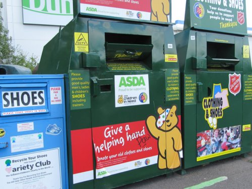 Given all the different ways to contribute, it took a while to pick a picture. Here is a series of bins where one can donate clothing items. Just one of many ways to contribute.