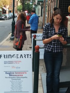 Leah waits with me outside of the Idiopathic Ridiculopathy Consortium's RHINOCEROS. Phindie's Official Fringe Bike Tour