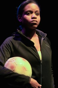 Aimé Donna Kelly in THE DANGEROUS HOUSE OF PRETTY MBANE at InterAct Theatre Company.