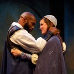 Othello (Forrest McClendon) puts his whole focus on Desdemona (Lauren Sowa) as they greet each other upon his arrival in Cyprus in the Philadelphia Shakespeare Theatre production of Othello. Photo by Chris Miller, Philadelphia Shakespeare Theatre.