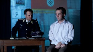 Rott (Steve Underwood) interrogates Bonhoeffer (Chase Byrd) against swastika background. Photo by © James Jackson.