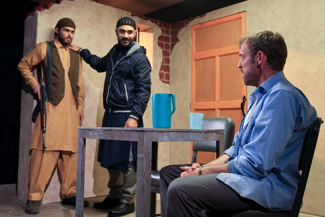 Anthony Mustafa Adair (left) with Maboud Hamidzadeh and Ian Merrill Peakes in THE INVISIBLE HAND. Photo by Paola Nogueras.