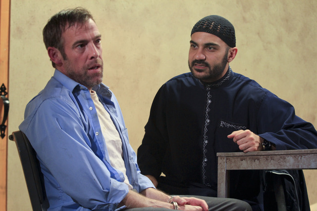 Ian Merrill Peakes (left) with Maboud Ebrahimzadeh in THE INVISIBLE HAND. Photo by Paola Nogueras.